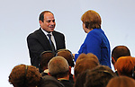German Chancellor Angela Merkel shakes hands with the President of Egypt, Abdel Fattah el-Sisi during a two-day G20 Africa partnership investment conference in Berlin on June 12, 2017. Photo by Egyptian President Office