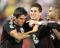 Julius James #2 and Santino Quaranta #25 of D.C. United with Jaime Moreno #99 after he had scored on a penalty kick during an MLS match against Toronto FC that was the final appearance of D.C. United's Jaime Moreno at RFK Stadium, in Washington D.C. on October 23, 2010. Toronto won 3-2.
