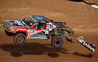 Apr 17, 2010; Surprise, AZ USA; LOORRS pro lite unlimited driver Sean Geiser takes a jump as bodywork flies off his truck during round 3 at Speedworld Off Road Park. Mandatory Credit: Mark J. Rebilas-US PRESSWIRE.