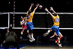 UNIVERSITY PARK, PA- MAY 7:  Shawn Sangrey #6 of the Ohio State Buckeyes spikes the ball against the blocks of Trey Valbuena #3 and Dylan Davis #13 of the UC Santa Barbara Gauchos during the 2011 NCAA Men's Volleyball Championship Final at Rec Hall in University Park, Pennsylvania on May 7, 2011. Sangrey had a game high 30 kills en route to Buckeye's first national title in volleyball.  (Photo by Donald Miralle) *** Local Caption ***