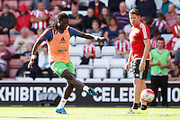 Bafetimbi Gomis warming up during the Barclays Premier League match between Southampton v Swansea City played at St Mary's Stadium, Southampton