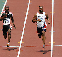 Kim Collins(left) of St. Kitts and Nevis ran 10.34sec. and Tyson Gay(right) of the USA ran 10.19sec. in the 1st. round of the 100m dash at the 11th. IAAF World Championships in Osaka, Japan on Saturday, August 25, 2007. Photo by Errol Anderson, The Sporting Image.