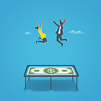 Businessman and businesswoman bouncing on dollar note trampoline