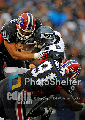 7 September 2008:  Seattle Seahawks' quarterback Matt Hasselbeck (8) is sacked by Buffalo Bills' defensive end Chris Kelsay (90) and defensive tackle Spencer Johnson (91) during a game at Ralph Wilson Stadium in Orchard Park, NY. The Bills defeated the Seahawks 34-10 in the season opening game...Mandatory Photo Credit: Ed Wolfstein Photo