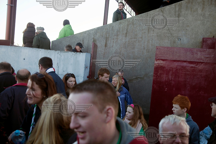 People at Tuam's Gaelic Football stadium.