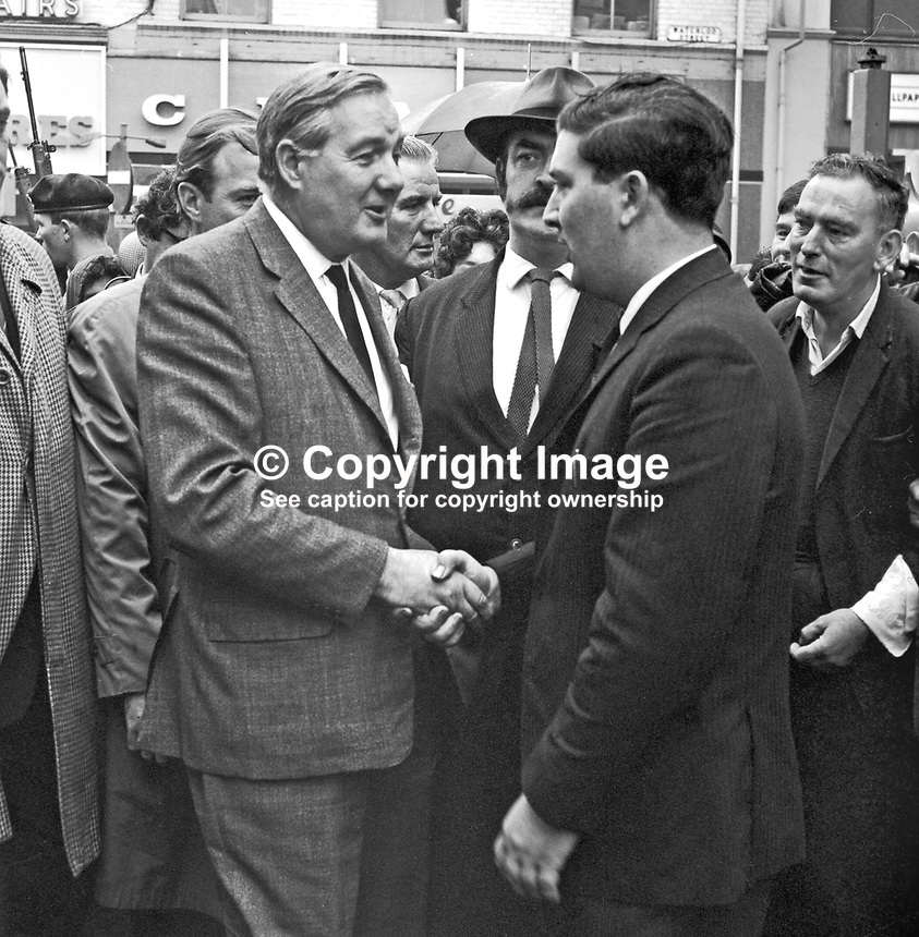 James Callaghan, British Home Secretary, is welcomed by John Hume, prominent member of the Derry Citizens&quot; Action Committee, in William Street, Londonderry, at the start of his walkabout in the Bogside where he met local residents. 196908270001 <br />
