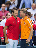 Switserland, Genève, September 20, 2015, Tennis,   Davis Cup, Switserland-Netherlands, Dutch Captain Jan Siemerink (R) congratulates Roger Federer with his victory<br /> Photo: Tennisimages/Henk Koster