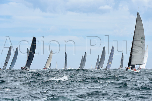 26.12.2015 Sydney, Australia. Rolex Sydney to Hobart Yacht race 2015. The rest of the fleet heads out to sea during the start of the 629 nautical mile race from Sydney to Hobart on Sydney Harbour. Frantic from NSW type TP52 Donovan.