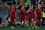 Calcio, Serie A: Roma vs Milan. Roma, stadio Olimpico, 22 dicembre 2012..AS Roma forward Pablo Daniel Osvaldo, left, celebrates with teammates after scoring after scoring during the Italian Serie A football match between AS Roma and AC Milan at Rome's Olympic stadium, 22 December 2012..UPDATE IMAGES PRESS/Isabella Bonotto