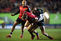 Darren Sweetnam of Munster Rugby is tackled by Jonny May of Leicester Tigers. European Rugby Champions Cup match, between Leicester Tigers and Munster Rugby on December 17, 2017 at Welford Road in Leicester, England. Photo by: Patrick Khachfe / JMP