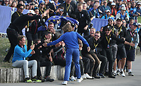 Tommy Fleetwood (Team Europe) celebrates with the groundkeepers after Europe win the Sunday's Singles, at the Ryder Cup, Le Golf National, Île-de-France, France. 30/09/2018.<br /> Picture David Lloyd / Golffile.ie<br /> <br /> All photo usage must carry mandatory copyright credit (© Golffile | David Lloyd)