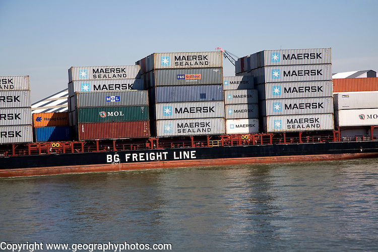 Heavily laden container ship of the BG Freight Line on the River Maas, Port of Rotterdam, Netherlands