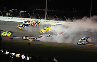 Jul. 5, 2008; Daytona Beach, FL, USA; NASCAR Sprint Cup Series drivers Sam Hornish Jr (77) J.J. Yeley (20) Johnny Sauter (70) Michael Waltrip (55) Travis Kvapil (28) Dave Blaney (22) and Reed Sorenson (41) are involved in a multi car accident on the last lap during the Coke Zero 400 at Daytona International Speedway. Mandatory Credit: Mark J. Rebilas-