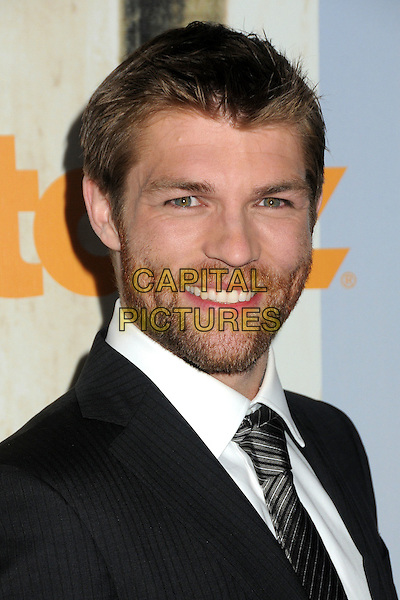 "Liam McIntyre.""Spartacus: Vengeance"" Premiere Screening held at Arclight Cinemas, Hollywood, California, USA..January 18th, 2012.headshot portrait black white stubble tie suit  beard facial hair.CAP/ADM/BP.©Byron Purvis/AdMedia/Capital Pictures."