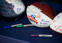 Players autographed footballs to give as gifts to sponsors and organizers.