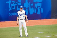 19 August 2007: Coach Joshua Ridgway stands next to third base during the Japan 4-3 victory over France in the Good Luck Beijing International baseball tournament (olympic test event) at the Wukesong Baseball Field in Beijing, China.