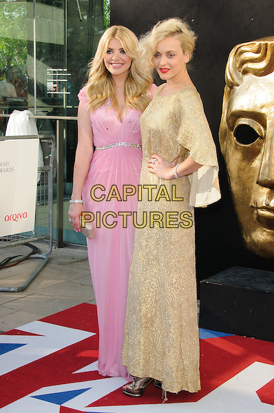 Holly Willoughby and Fearne Cotton.Arrivals at the Arqiva British Academy Television Awards held at the Royal Festival Hall, London, England..May 27th, 2012.BAFTA BAFTAS full length pink gold dress hand on hip.CAP/CJ.©Chris Joseph/Capital Pictures.