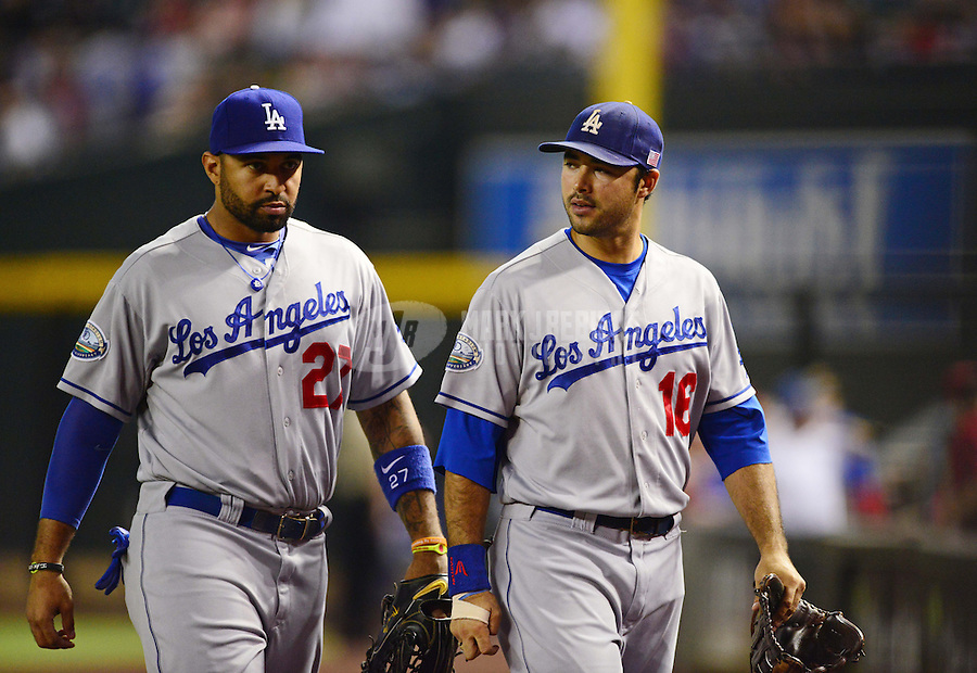Sept. 11, 2012; Phoenix, AZ, USA: Los Angeles Dodgers outfielders Matt Kemp (left) and Andre Ethier head to the dugout following the third inning against the Arizona Diamondbacks at Chase Field. Mandatory Credit: Mark J. Rebilas-