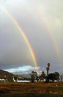 Twin rainbow near Esennada..SCORE Baja 2000, Ensenada, Baja California, Mexico.12-14 November,2000 copyright©F.Peirce Williams 2000...F. Peirce Williams .photography.P.O.Box 455 Eaton, OH 45320.p: 317.358.7326  e: fpwp@mac.com.
