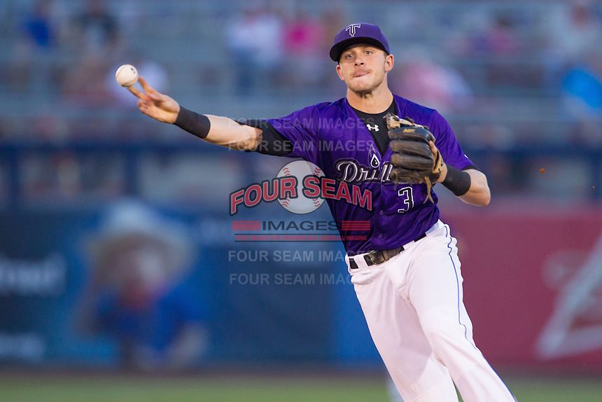 Tulsa Drillers second baseman Trevor Story (3) throws to first base during the Texas League game against the Frisco RoughRiders at ONEOK field on August 15, 2014 in Tulsa, Oklahoma  The RoughRiders defeated the Drillers 8-2.  (William Purnell/Four Seam Images)