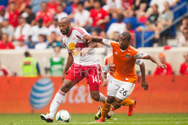 Thierry Henry (14) of the New York Red Bulls is marked by Corey Ashe (26) of the Houston Dynamo. The New York Red Bulls defeated the Houston Dynamo 2-0 during a Major League Soccer (MLS) match at Red Bull Arena in Harrison, NJ, on June 30, 2013.