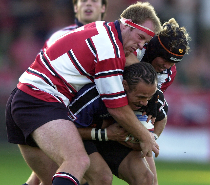 Photo: Richard Lane..Gloucester v Glasgow Rugby Pre seaon friendly. 14/08/2003..David Millard is tackled by Peter Buxton and Jake Boer.