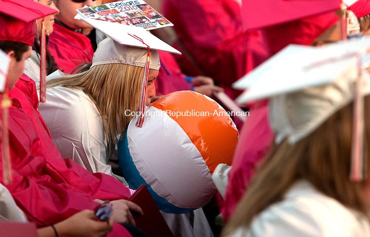 WOLCOTT, CT 18 JUNE, 2010-061810JS04-Wolcott High School graduate Allana Kizis secretly blows up a beach ball during graduation ceremonies at Wolcott High School in Friday. <br /> Jim Shannon Republican-American