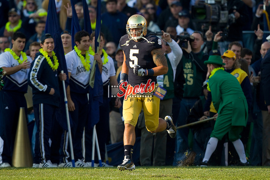 Manti Te'o (5) of the Notre Dame Fighting Irish takes the field on Senior Day prior to the game against the Wake Forest Demon Deacons at Notre Dame Stadium on November 17, 2012 in South Bend, Indiana.  The Fighting Irish defeated the Demon Deacons 38-0.  (Brian Westerholt/Sports On Film)
