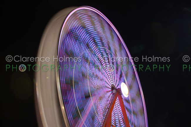 AUGUSTA, NJ - AUGUST 13: The colorfully illuminated Gentle Giant Ferris Wheel spins against the night sky during the New Jersey State Fair on August 13, 2010 at the Sussex County Fairgrounds, Augusta, New Jersey