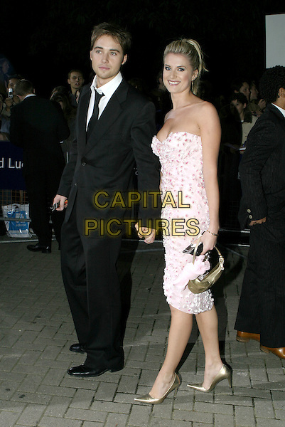 SARAH DUNN - SARA.The National Television Awards, Royal Albert Hall..October 26th, 2004.holding hands, floral dress, strapless.www.capitalpictures.com.sales@capitalpictures.com.© Capital Pictures.