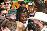 Former Baylor quarterback, Robert Griffin III, unveils a new statue of himself during the opening ceremonies of the new Baylor Stadium before the game between the Southern Methodist Mustangs and the Baylor Bears at the McLane Stadium in Waco, Texas.