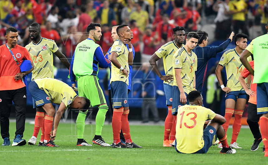SAO PAULO – BRASIL, 28-06-2019: Jugadores de Colombia lucen decepcionados tras la eliminación después del partido por cuartos de final de la Copa América Brasil 2019 entre Colombia y Chile jugado en el Arena Corinthians de Sao Paulo, Brasil. / Players of Colombia look disapponted after their elimination in the Copa America Brazil 2019 quarter-finals match between Colombia and Chile played at Arena Corinthians in Sao Paulo, Brazil. Photos: VizzorImage / Julian Medina / Cont /