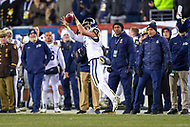 PHILADELPHIA, PA - DEC 8, 2018: Navy Midshipmen wide receiver OJ Davis (86) throws a flea flicker pass to Navy Midshipmen quarterback Garret Lewis (7) late in the fourth quarter of game between Army and Navy at Lincoln Financial Field in Philadelphia, PA. Army defeated Navy 17-10 to win the Commander in Chief Cup. (Photo by Phil Peters/Media Images International)
