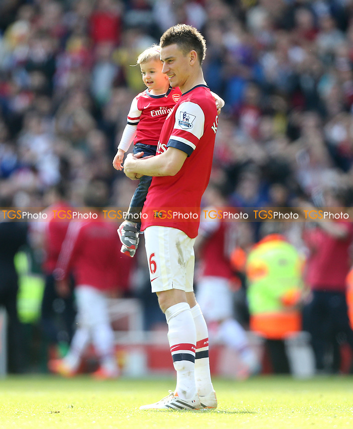 Laurent Koscielny of Arsenal during the lap of honour at the end of the game - Arsenal vs West Bromwich Albion, Barclays Premier League at The Emirates Stadium, Arsenal, London - 04/05/14 - MANDATORY CREDIT: Rob Newell/TGSPHOTO - Self billing applies where appropriate - 0845 094 6026 - contact@tgsphoto.co.uk - NO UNPAID USE
