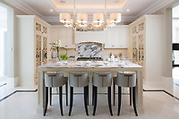 BNPS.co.uk (01202 558833)<br /> Pic: Savills/BNPS<br /> <br /> Kitchen breakfast room.<br /> <br /> Fairway to Heaven - Hills End has been described as 'a fabulous new masterpiece'. <br /> <br /> This breathtaking brand new mansion only a pitching wedge from one the most exclusive golf clubs in the country has emerged for sale for a whopping £22m.<br /> <br /> Hills End nestles within the prestigious Sunningdale estate in Surrey, home of the £4,000 a year Sunningdale Golf Club which dates back to 1900 and has hosted the Women's British Open and the Senior Open Championship.<br /> <br /> The newly-built property sits on a 1.75 acre plot  boasting six bedrooms, eight reception areas, a swimming pool complex with spa, sauna and yoga rooms along with a large cinema. and walk in wardrobes.<br /> <br /> The incredible Palladian style home is on the market with estate agents Savills who describe it as 'a fabulous new masterpiece'...that comes with a whopping £22 million price tag.