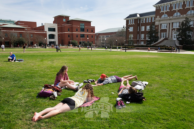 Drill Field Spring Day, friends enjoying the sun:  Anna Dupre (maroon, ard421), Bailey Jakab (light green, bj676), Kindall Ross (in grey, ktr97), and  Sarah Beth Pritchard (in yellow, sp1465).<br />  (photo by Megan Bean / &copy; Mississippi State University)