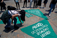 MEDELLIN, COLOMBIA - SEPTEMBER 28: Women organize green cloth banners to be placed on sculptures of Colombian artist Fernando Botero during a protest  in Medellin, Colombia on September 28, 2019. Several groups place green cloth banners on the faces of sculptures by artist Fernando Botero, protesting in the framework of the day of global action for access to legal and safe abortion, a symbolic action for women's rights. (Photo by VIEWPRESS/ Fredy Builes Corbis via Getty Images)