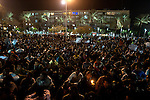 African asylum-seekers gather after marching through the streets of Tel Aviv, Israel, protesting against the governmental act to move all illegal African immigrants to a detention facility, and calling the Israeli government to grant them basic civil rights.