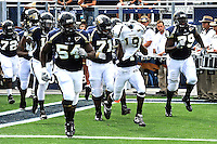 9 October 2010:  FIU's team takes the field carrying a jersey in honor of their slain teammate, Kendall Berry.  The FIU Golden Panthers defeated the Western Kentucky Hilltoppers, 28-21, at FIU Stadium in Miami, Florida.