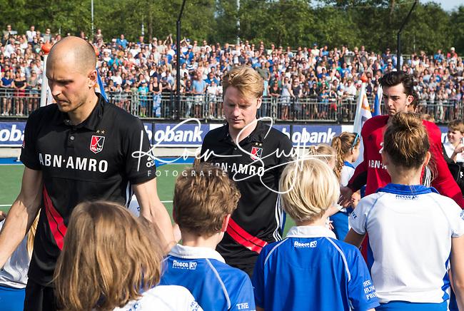 UTRECHT -  Teleurstelling bij Klaas Vermeulen (A'dam) en links Justin Reid-Ross.   na  de finale van de play-offs om de landtitel tussen de heren van Kampong en Amsterdam (3-1).    COPYRIGHT KOEN SUYK