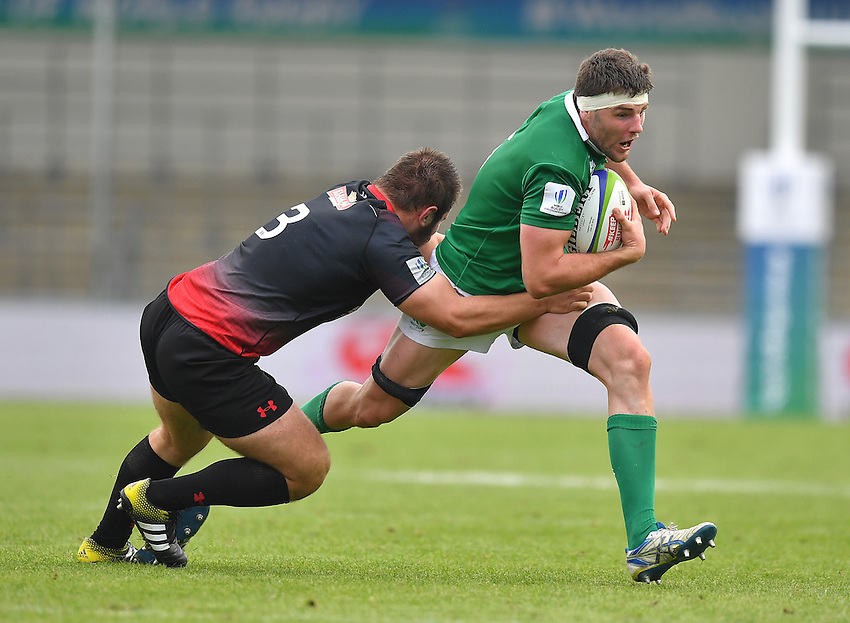 Ireland's Sean O'Connor is tackled by Georgia's Lasha Tabidze<br /> <br /> Photographer Dave Howarth/CameraSport<br /> <br /> International Rugby Union - U20 World Rugby Championships 2016 - Pool B - Match 17 - Pool A Ireland U20 v Georgia U20 - Wednesday 15th June 2016 - Manchester City Academy Stadium - Manchester<br /> <br /> World Copyright &copy; 2016 CameraSport. All rights reserved. 43 Linden Ave. Countesthorpe. Leicester. England. LE8 5PG - Tel: +44 (0) 116 277 4147 - admin@camerasport.com - www.camerasport.com<br /> <br /> Photographer Stephen White/CameraSport<br /> <br /> International Rugby Union - U20 World Rugby Championships 2016 - Pool C France U20 v Argentina U20 - Match 1 - Tuesday 07th June 2016 - AJ Bell Stadium - Salford - England<br /> <br /> World Copyright &copy; 2016 CameraSport. All rights reserved. 43 Linden Ave. Countesthorpe. Leicester. England. LE8 5PG - Tel: +44 (0) 116 277 4147 - admin@camerasport.com - www.camerasport.com