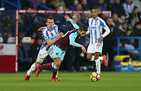 West Ham United's Manuel Lanzini and Huddersfield Town's Jonathan Hogg<br /> <br /> Photographer Rob Newell/CameraSport<br /> <br /> The Premier League - Huddersfield Town v West Ham United - Saturday 13th January 2018 - John Smith's Stadium - Huddersfield<br /> <br /> World Copyright &copy; 2018 CameraSport. All rights reserved. 43 Linden Ave. Countesthorpe. Leicester. England. LE8 5PG - Tel: +44 (0) 116 277 4147 - admin@camerasport.com - www.camerasport.com