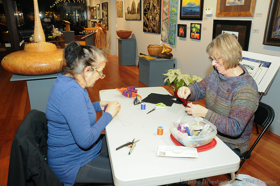 Artist Joan Hitchcock leads a felted brooch activity at the Rectangle Gallery.<br />