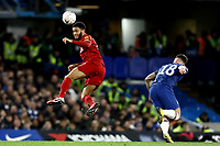 3rd March 2020; Stamford Bridge, London, England; English FA Cup Football, Chelsea versus Liverpool; Joe Gomez of Liverpool heads the ball away from Olivier Giroud of Chelsea