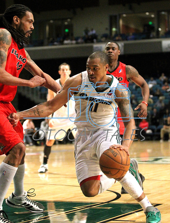 Reno Bighorns Will Blalock drives past Idaho Stampede's Mikki Moore during a basketball game Sunday, April 1, 2012 in Reno, Nev. Idaho won 108-99..Photo by Cathleen Allison