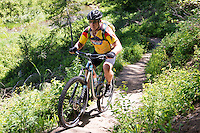 A mountain biker rides the Chestnut Mountain trail east of Bozeman.