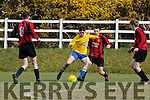 Patrick Carey Killorglin creating havoc in the Mastergeeha defence during their clash in Killorglin on Saturday