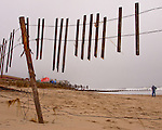 The remains of a sand fence frame the beach at Rehoboth Beach, Delaware, USA, following a nor'easter storm in November, 2009.