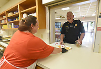 NWA Democrat-Gazette/FLIP PUTTHOFF <br /> THANK YOU GRAVETTE FIRST RESPONDERS<br /> Tina Holcomb serves breakfast on Wednesday June 5 2019 to Officer Mike Savage with the Gravette Police Department during an appreciation breakfast at the Billy V. Hall Gravette Senior and Wellness Center. Firefighters and law enforcement were treated to breakfast as thanks from the center for their work in the city.