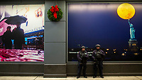 NEW YORK, NY - DECEMBER 1: NYPD officers stand guard at one of the entrance of the Marriott International hotel in Times Square on December 1, 2018 in New York. The largest hotel chain in the world, The Marriott International, has announced that it had suffered a massive data breach that affected round 500 million customers worldwide. (Photo by Eduardo MunozAlvarez/VIEWpress)